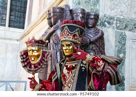 VENICE, ITALY - MARCH 6: Detail of unidentified masked person standing in front of St. Mark church in Venice, Italy, on 6 March during Venice carnival (held on 26 February - 8 March 2011). - stock photo