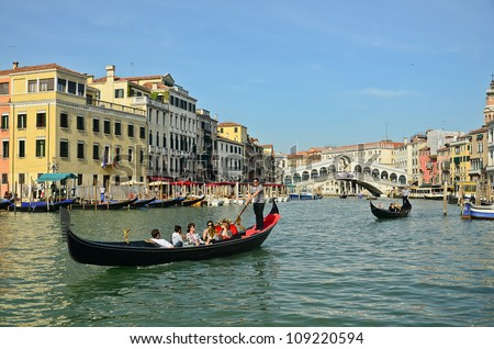 VENICE, ITALY - MARCH 28: Gondola at Rialto Bridge on March 28, 2012 in Venice, Italy. There were several thousand gondolas in the 18th century, with only several hundred today for tourism.