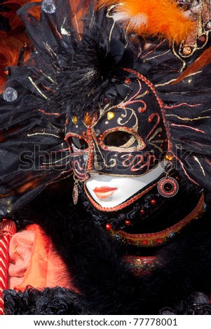 VENICE, ITALY - MARCH: Participant with a mask on in St. Mark's Square, Carnival of Venice on March, 2011 in Venice, Italy. The carnival was held from February 26 to March 8, 2011. - stock photo