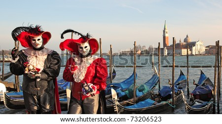 VENICE, ITALY - MARCH 04: Unidentified participants wear traditional mask and costume during famous Venetian Carnival on March 04, 2011 in Venice, Italy.