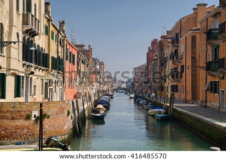 VENICE, Italy, March 19 2016: Water canal in the Jewish Ghetto, the historical city of Venezia in Italy