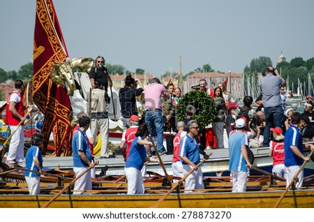 VENICE, ITALY - MAY 17, 2015:  A large wreath being thrown into the lagoon during the Marriage of the Sea ceremony at Lido, Venezia. The historic event marks Ascension Day.  - stock photo