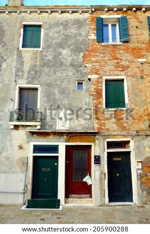VENICE, ITALY - MAY 9, 2014: A typical building built on a canal in Venice, Italy.