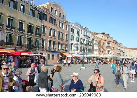 VENICE, ITALY - MAY 8, 2014: Historical buildings and visitors along Riva degli Schiavoni in Venice, Italy.