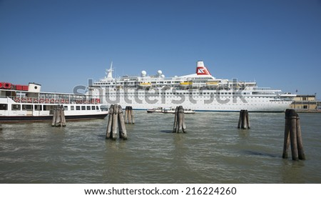 VENICE,ITALY- MAY 10,: Large white Fred Olsen Cruise Liner at the wharf on May 9, 2011 in Venice, Italy. Venice is one of the most visited harbors in Europe and cruising is a major tourist activity. - stock photo