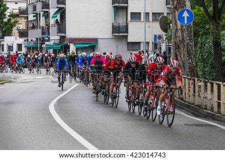 Venice, Italy - 19 May 2016: Leaders of the second pack of cyclists pass through Mestre, near Venice, on the 12th stage of 99th Giro d'Italia in northeast Italy, as spectators look on.