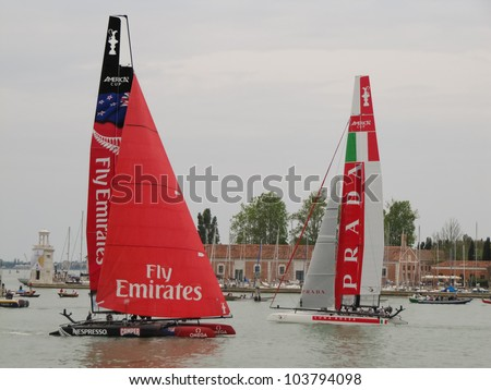 VENICE, ITALY - MAY 20: Luna Rossa (Piranha) and Artemis Team in the S.Marco sailing area during the final fleet race (ACWS) in May 20, 2012 in Venice, Italy. - stock photo