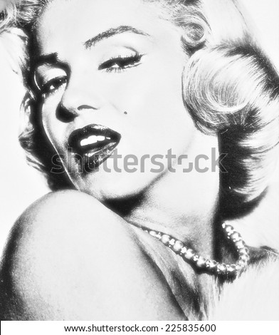 VENICE, ITALY - MAY 6, 2012: Print depicting movie star Marilyn Monroe in famous posing is exhibited in Venetian print shop - stock photo