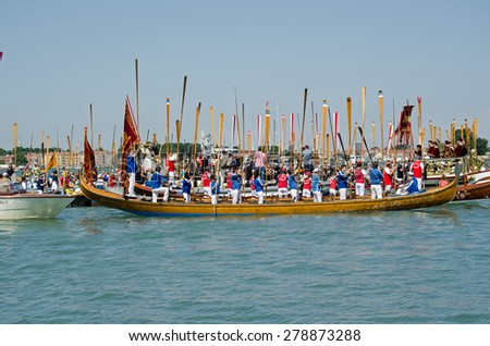 VENICE, ITALY - MAY 17, 2015:  Rowers standing with their oars to attention during the Marriage with the Sea ceremony, part of Festa della Sensa to mark Ascension Day in Venice Lido. - stock photo