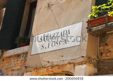 VENICE, ITALY - MAY 06, 2014: Street name on a wall of Italian house in Venice, Italy - stock photo