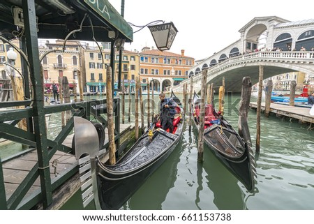 VENICE, ITALY - MAY 07, 2017: The Rio di San Cassiano Canal with boats and colorful facades of old medieval houses.
