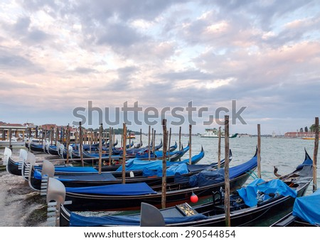 Venice, Italy - May 20, 2015: View of gondolas moored at the quay in the Piazza San Marco at sunset. - stock photo