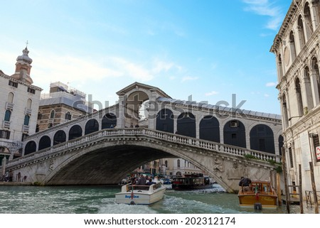 VENICE, ITALY - NOVEMBER 04, 2013: Beautiful view of Rialto's Bridge and the Canal Grande in Venice. Venice is one of the most popular tourist destinations in the world