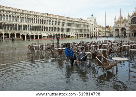 VENICE, ITALY - NOVEMBER 14, 2016:Flooding (Acqua alta )hit the city due to abnormal high tides caused by the supermoon  in November 14,2016 in Venice, Italy