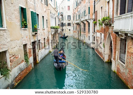 VENICE,ITALY - November 7,2016: View of gondola boat service customer and tourist people in Venice canal and river ,Italy.
