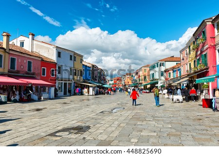 VENICE, ITALY - 17 OCTOBER 2015: Busy shopping street in famous Burano with its colorful houses near Venice, Italy - stock photo