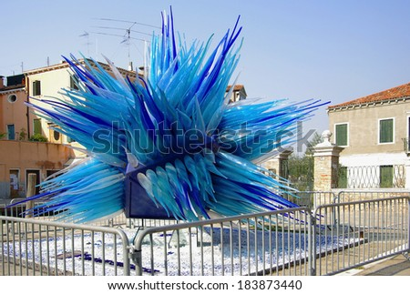 VENICE, Italy - OCTOBER 06: Murano island on October 06, 2011 Venice, Italy. Giant blue murano glass sculpture on Murano island, which is famous for its glass making, particularly lampworking - stock photo
