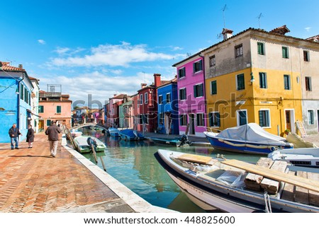 VENICE, ITALY - 17 OCTOBER 2015: Street scene in famous Burano with its colorful houses near Venice, Italy - stock photo