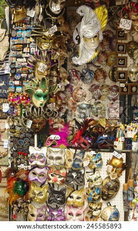 VENICE, ITALY - OCTOBER 8, 2011: Vendor stands - profitable and popular form of sales of traditional souvenirs such as the traditional venetian masks. Photo taken at Gran Canal Venice on oct. 8, 2011