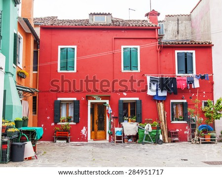 VENICE, ITALY, on APRIL 30, 2015. Architecture of multi-colored lodges of locals on Burano's island. Burano - one of islands of the Venetian lagoon