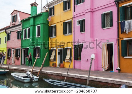VENICE, ITALY, on APRIL 30, 2015. Burano island, multi-colored houses of locals. Burano the island - one of attractive tourist objects in the Venetian lagoon