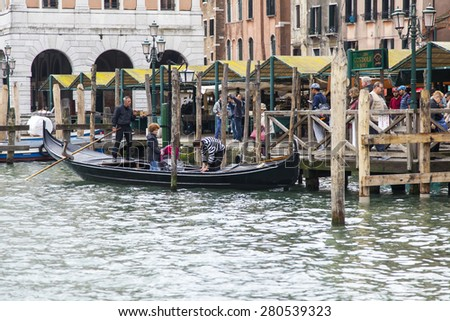VENICE, ITALY - on APRIL 29, 2015. The gondola waits for passengers at the canal embankment