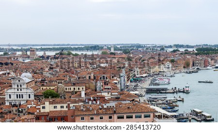 VENICE, ITALY - on APRIL 30, 2015. The top view from San Marco kampanilla on the coast of the Venetian lagoon and the moored ships