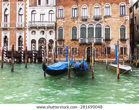 VENICE, ITALY - on APRIL 30, 2015. Typical urban view. The coast of the Grand channel (Canal Grande) and gondolas. The grand channel is the main transport artery of Venice and its most known channel
