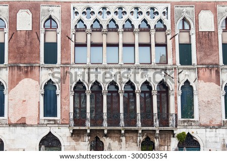 VENICE, ITALY - on MAY 4, 2015. A fragment of a facade of a typical palace in island part of the city - stock photo