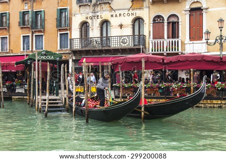 VENICE, ITALY - on MAY 4, 2015. A view from a board vaporetto on the coast of the Grand channel (Canal Grande) and gondola at moorings