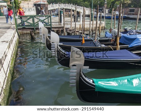 VENICE, ITALY - on MAY 2, 2015. City landscape early in the morning. Gondolas are moored at the coast of the channel