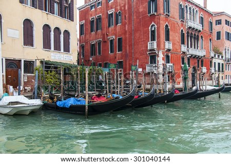 VENICE, ITALY - on MAY 4, 2015. Gondolas are moored about the coast of the Grand channel (Canal Grande). Ancient palaces on the embankment