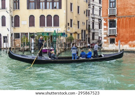 VENICE, ITALY - on MAY 3, 2015. People cross on ????????? via the Grand channel (Canal Grande). Vaporetto is a main type of public transport in Venice