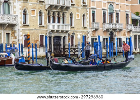 VENICE, ITALY - on MAY 3, 2015. The gondola with passengers floats on the Grand channel (Canal Grande)