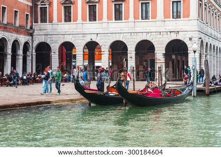 VENICE, ITALY - on MAY 4, 2015. Walk on a gondola on the Grand channel (Canal Grande) - one of the most known tourist attractions in Venice. Passengers take places in a gondola