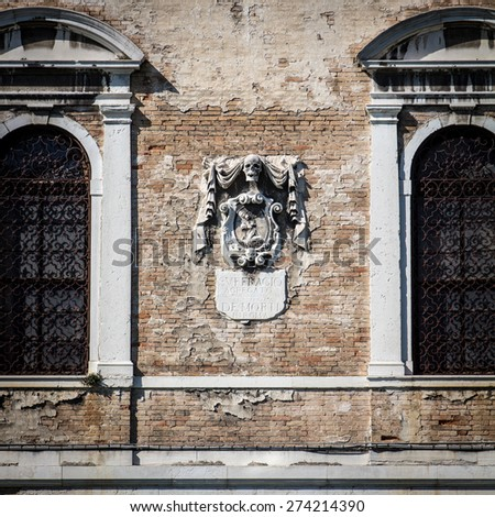 Venice, Italy particular of the facade of the school of the dead on grand canal - stock photo