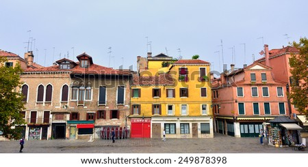 VENICE, ITALY - SEP 27, 2014: Campo Santa Margherita at sunrise. Tourists from all the world enjoy the historical city of Venezia in Italy, famous UNESCO World Heritage Site - stock photo