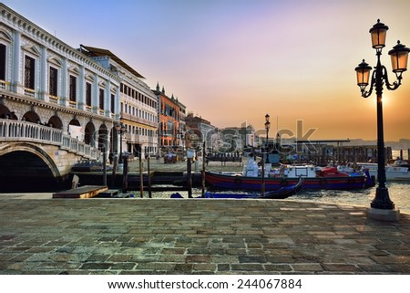 VENICE, ITALY - SEPT 27, 2014: View on San Marco square and  bridge of Sighs at sunrise. Venice and the Venetian lagoon are on the UNESCO World Heritage List - stock photo