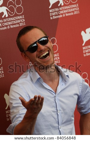 VENICE, ITALY - SEPTEMBER 02: Actor Michael Fassbender poses at the 'A Dangerous Method' photocall at the Palazzo del Cinema during the 68th Venice Film Festival on September 2, 2011 in Venice, Italy - stock photo