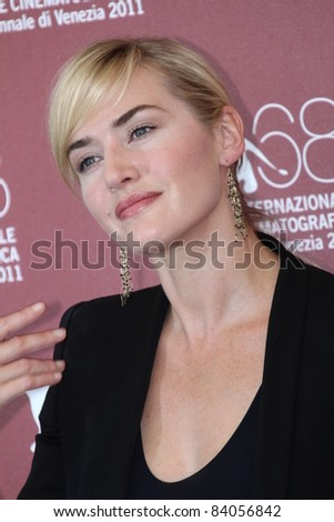 VENICE, ITALY - SEPTEMBER 02: Actress Kate Winslet poses at the 'Mildred Pierce' photocall at the Palazzo del Cinema during the 68th Venice Film Festival on September 2, 2011 in Venice, Italy. - stock photo