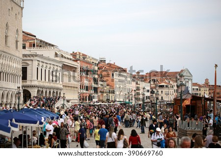 VENICE, ITALY - SEPTEMBER 22: Beautiful view of famous Saint Marko square full of crowds of tourists walking and going sightseeing on background of ancient amazing old buildings outdoor, horizontal