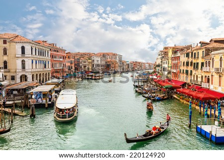 Venice, Italy  - 4 September, 2014: Boats and gondolas on the Grand Canal of Venice. Venice is the most popular tourist destination in Italy.