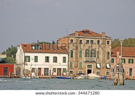 VENICE, ITALY - SEPTEMBER 04, 2012: Buldings on the island Murano, Italy - stock photo