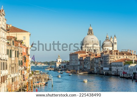 VENICE,ITALY - SEPTEMBER 23,2014 - Canal Grande with Basilica Santa Maria della Salute. In Venice are more than 120 churches and temples.