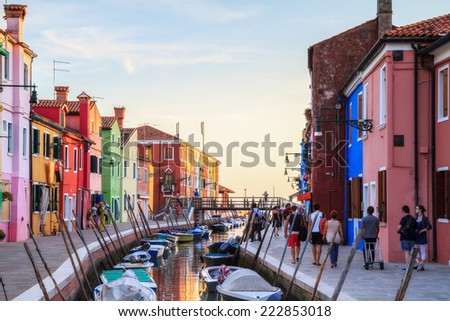 VENICE, ITALY - SEPTEMBER 08 2013: Colorful Burano. Amazing colored historical buildings from the early 20th century at the lagoon island of Burano near Venice