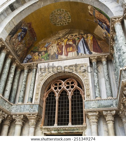 VENICE, ITALY - SEPTEMBER 4, 2014: Detail of the ornate outer architecture and paintings of Saint Mark's Basilica in Venice, Italy - stock photo