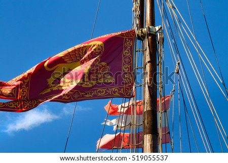 VENICE, ITALY - September 11, 2014:  Flag of Venice on a mast of the sailing ship against the blue sky