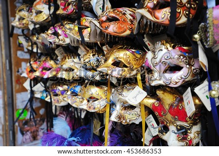 VENICE, ITALY - SEPTEMBER 15, 2015: Gift shop in the center of Venice. There are many souvenirs items such as bright colorful masks for masquerade with unusual patterns.