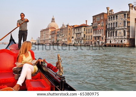VENICE, ITALY - 29 SEPTEMBER 2009: Gondolier rides gondola on the Grand Channel on September 29, 2009. The profession of gondolier is controlled by a guild, which issues a limited number of licenses.