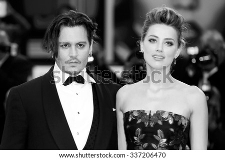 VENICE, ITALY - SEPTEMBER 5: Johnny Depp and Amber Heard attend the premiere of  'THE DANISH GIRL' during the 72nd Venice Film Festival on September 5, 2015 in Venice, Italy. - stock photo